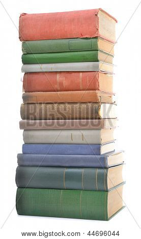 Stacked old books of different shape and color isolated on white background