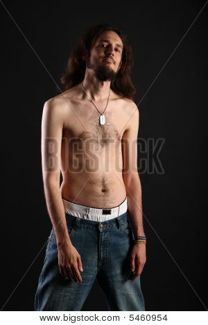 Portrait Of Rebel With Long Hair And Topless Slim Body Isolated On Black Background