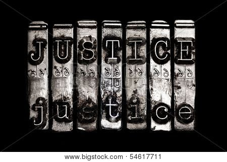 Justice concept in metal type on black poster