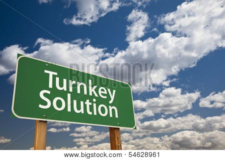 Turnkey Solution Green Road Sign with Dramatic Sky and Clouds.