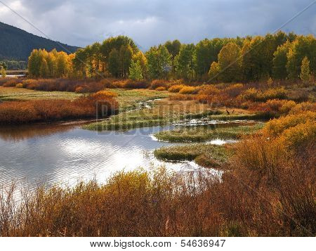 Late evening landscape viewas seen from the banks of Oxbow Bend in the Grand Tetons National Park near Mt. Moran, Wyoming USA poster