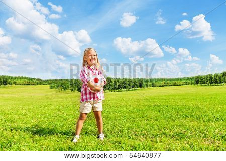 Girl In The Field With Ball