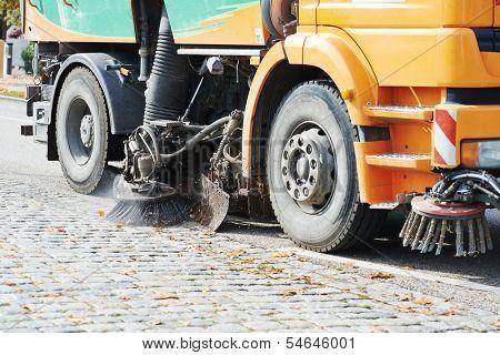 Process of urban street cleaning. Municipal machanical truck