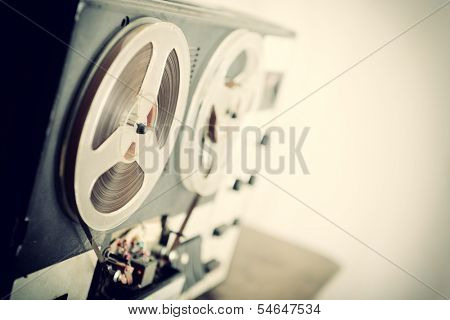 Old portable reel to reel tube tape-recorder, toned, with copyspace