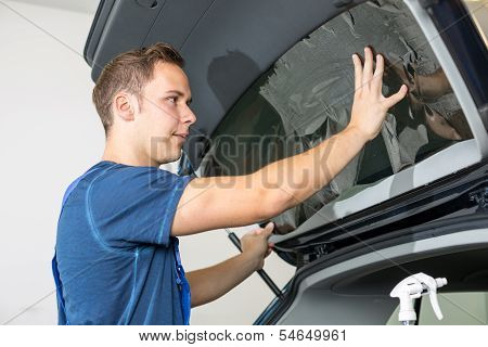 Car Wrappers Tinting A Vehicle Window With A Tinted Foil Or Film