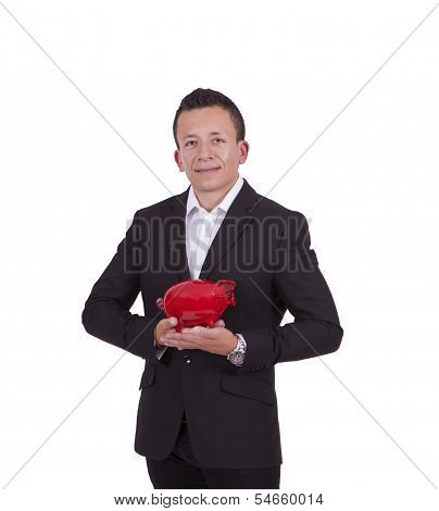 Smiling young businessman posing with a piggy bank
