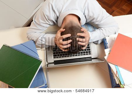 Stressed Student Or Businessman Head On Keyboard