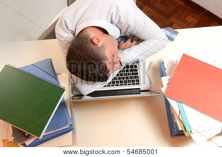 Stressed And Overworked Businessman Sleeping