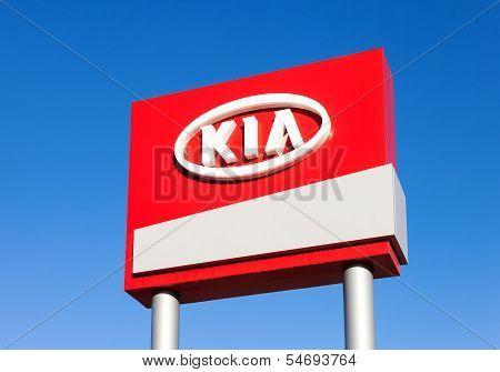 Samara, Russia - November 23: The Emblem Kia Motors On Blue Sky Background, November 23, 2013 In Sam