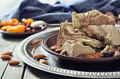 Halva with almonds and raisins on plate closeup poster