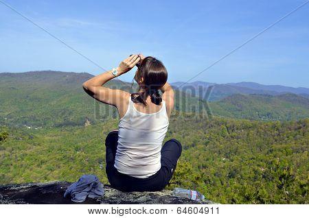 Woman on Mountain with Binoculars