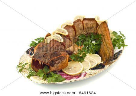 Bloated Fresh-water Catfish (sheatfish) With Lemon