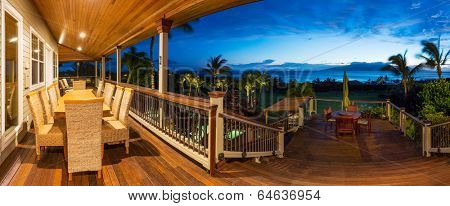 Beautiful Home Exterior Patio Deck and Dining Table with Sunset View