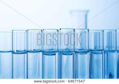 many test tubes for an experiment in a research laboratory of a university. learning and researching symbolic photo for.