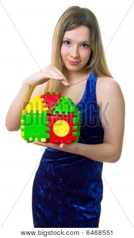 Girl Holds The Toy House
