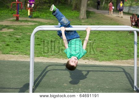 little boy playing sports