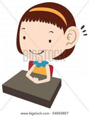 Illustration of school girl at her desk.