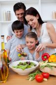 Happy family cooking together in the kitchen poster