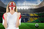 Excited fan england in face paint cheering against large football stadium with brasilian fans poster