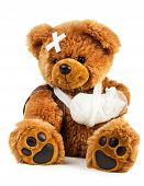 Teddy bear with bandage isolated on white background poster