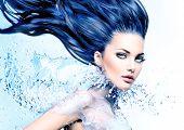 Fashion model girl with water splash collar and long blowing blue hair. Fantasy Woman. Mermaid. Fresh Water splashing poster