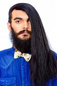 Portrait of a young brunet man with a beard and long haired. Hairstyle. Isolated over white. poster