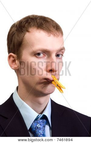 Businessman With Clothespin On His Mouth