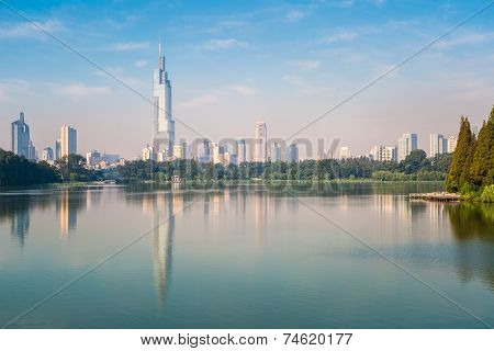 Modern City Building Reflected In The Lake
