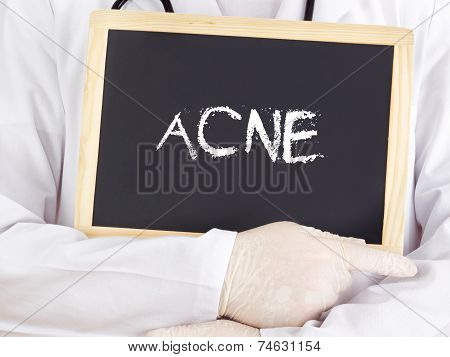 Doctor Shows Information On Blackboard: Acne