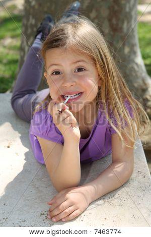Girl sucking lollipop