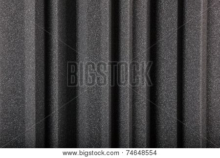 poster of black gray microfiber foam insulation for noise in music studio or acoustic halls rooms or houses professional studio insulation material noise isolation noise isolating protective and shock absorber foam wall background of acoustic foam wall macro