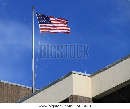 United States Flag on top of a building