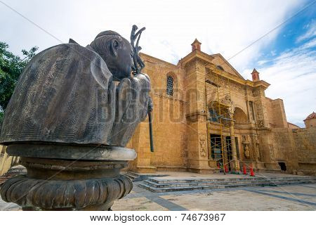 Statue of John Paul the second in front of the oldest cathedral in Americas Santa Maria la Menor San