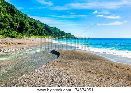 Mouth of the river to the sea on Playa Sana Rafael Beach Barahona Dominican Republic