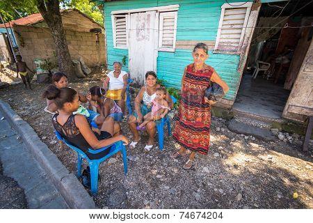 Unidentified local family enjoying midday siesta in village near Barahona