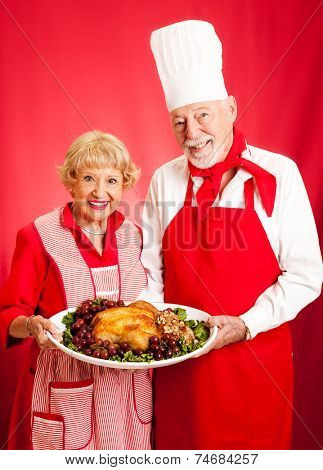 Senior couple works together to prepare a delicious holiday meal.