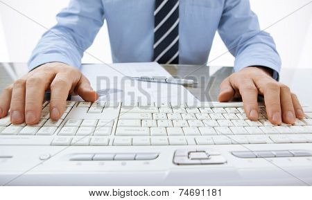 Man's hands typing