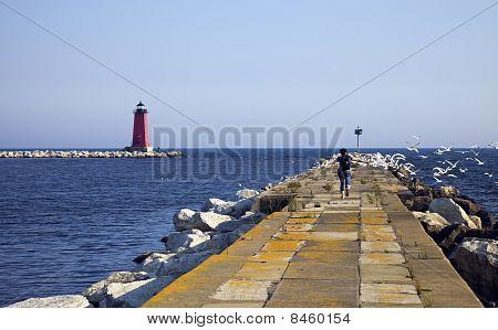 Tourist Running On The Pier