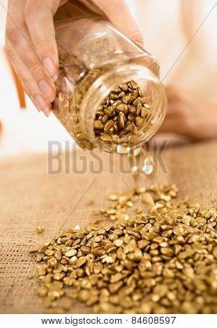 Closeup Shot Of Woman Holding Bullion Full Of Gold Nuggets