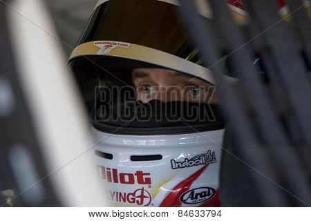 Daytona Beach, FL - Feb 18, 2015:  Michael Annett (46) straps into his car before a practice session for the Daytona 500 at Daytona International Speedway in Daytona Beach, FL.
