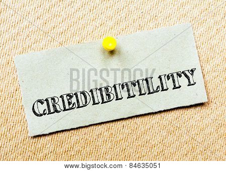 Recycled paper note pinned on cork board. Credibility Message. Concept Image poster