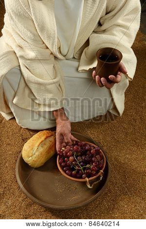 Jesus with bread wine and grapes on a vertical format