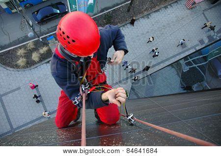 Alpinist Climbs The Building
