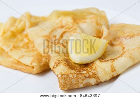 Pancakes English-style, with sugar and lemon, most traditionally served on Shrove Tuesday aka