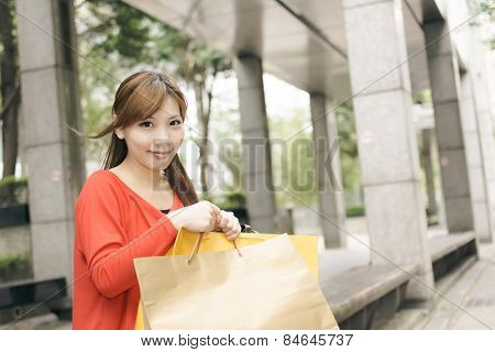Smile shopping woman sit and rest in Xinyi district, the business and commercial center in Taipei, Taiwan, Asia.