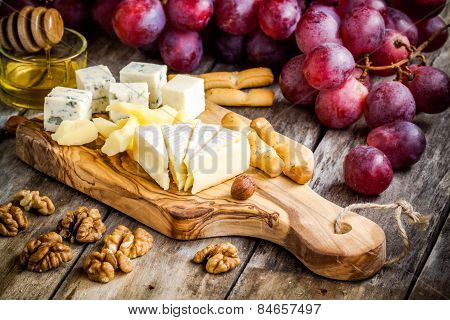 Cheese Plate: Camembert, Parmesan, Blue Cheese, Bread Sticks, Walnuts, Hazelnuts, Honey, Grapes