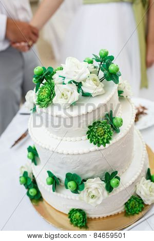 green and White Wedding Cake with Roses, chrysanthemum flowers and apples