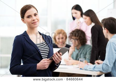 Young businesswoman holding tablet computer
