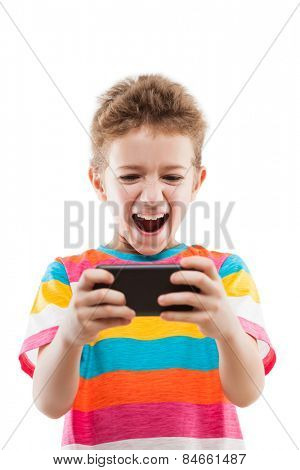 Little smiling child boy playing games or surfing internet on digital smartphone computer white isolated