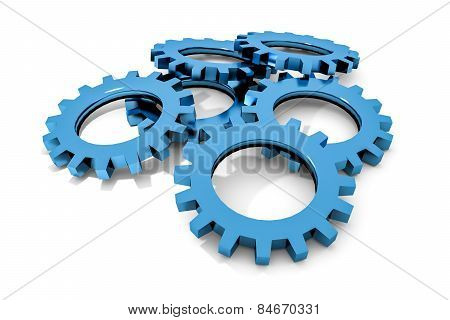 Stack Of Blue Colored Metallic Cogwheels On White Surface